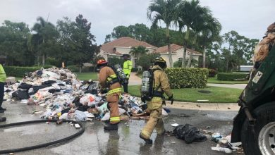 Photo of FIREFIGHTERS DUMP WATER ONTO FIRE IN TRASH TRUCK ON PORT ST. LUCIE
