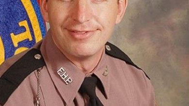 Photo of Florida law enforcement officer accompany slain Trooper's body